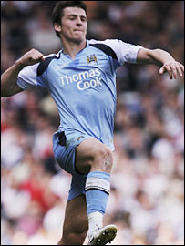 Joey Barton celebrates scoring Manchester City's opening goal
