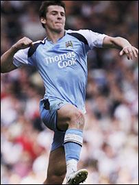 Joey Barton celebrates scoring Manchester City's opening goal