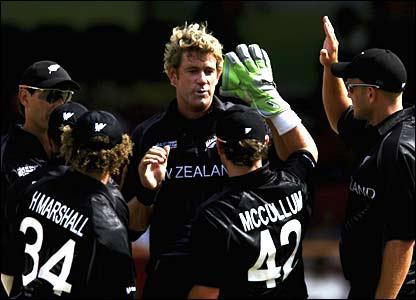 Jacob Oram celebrates the wicket of Eoin Morgan