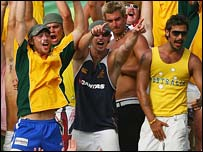 Australian fans celebrate during their victory against England