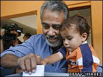 Xanana Gusmao votes with son Daniel in Balibar, East Timor, on 9 April 2007