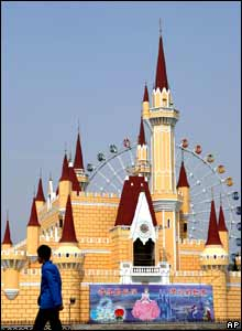 A visitor walks past a replica of Cinderella's Castle at the Shijingshan Amusement Park in Beijing.