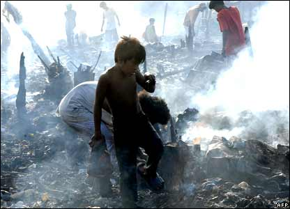 Residents scavenge through ruins of a fire in Manila, the Philippines.