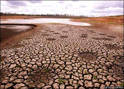 Cracked earth is visible as a result of declining water levels at Wivenhoe Dam on April 10, 2007 at Wivenhoe, Australia.