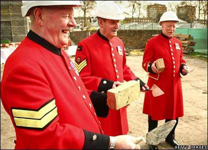 Chelsea pensioners (R-L) Brian Wells, Patrick Kaine, Bill Moylan and Norman Mitchell stand with bricks and trowels near a new Infirmary at the Royal Hospital Chelsea, London.