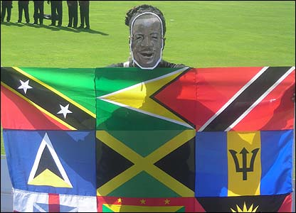 Mencielita Manning's photo shows a Brian Lara fan holding a colourful flag that includes the flags of the various West Indies countries