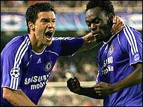 Michael Ballack (left) celebrates with match-winner Michael Essien