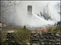 Hendersonville firefighters spray water on hot spots at the former home of the late Johnny Cash in Hendersonville.
