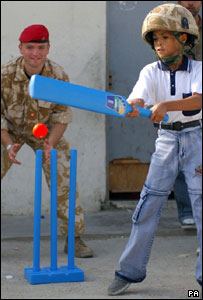 Major Andrew Banks with a young Iraqi