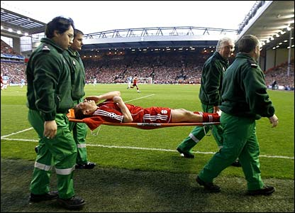 Craig Bellamy is taken from the field with a knee ligament injury