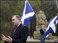 Alex Salmond at Wallace Monument with Saltire