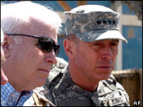 John McCain (l) with Gen David Petraeus in Iraq, April 2007