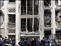 Rescuers inspect damage after a suicide attack in the centre of Algiers