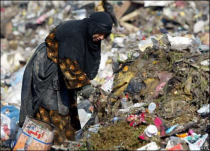 Woman at Baghdad rubbish dump