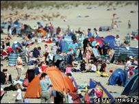 Holidaymakers on Sennen beach, Cornwall