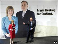 Alex Salmond and Nicola Sturgeon with backdrop of themselves