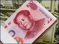 A pack of Chinese Yuan bills next to US dollar notes