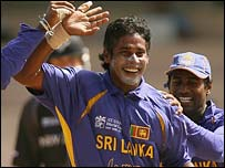 Chaminda Vaas celebrates after taking two early wickets