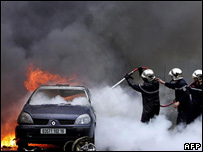 Fireman battle blazing car after Algiers bomb