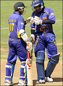 Sanath Jayasuriya (left) and Kumar Sangakkara celebrate their 100 partnership