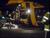 The first four rescued men were brought to Tingwall Airport