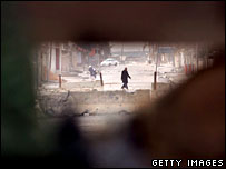 An Iraqi civilian seen from a shooting position at an observation post in Ramadi, Iraq