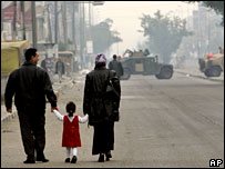 A family approaches a US checkpoint in Baghdad (file picture)