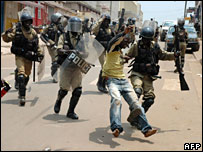 Ugandan police arrest a man at the protest