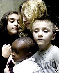 Madonna with her children, Lourdes (left), Rocco (right) and David Banda