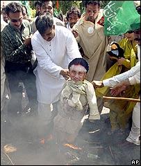 Protesters burn an effigy of President Musharraf