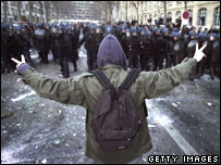 French demonstrator stands in front of riot police - Paris March 2006