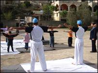 Soldiers teaching yoga