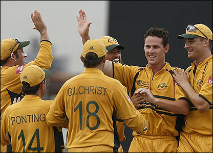 Shaun Tait is congratulated by his Australianm team-mates