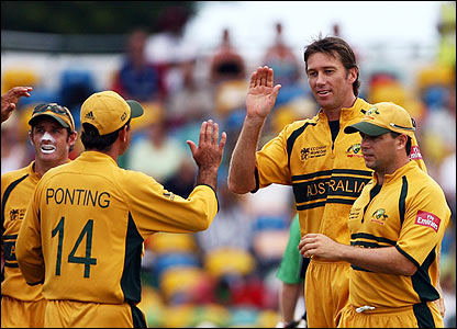McGrath is congratulated by his Australian team-mates after dismissing Eoin Morgan