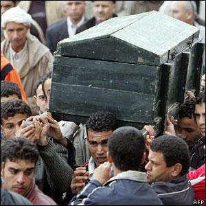 Men carrying the coffin of Roukhi Mohamed in Algeria