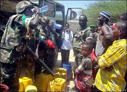 A Ugandan soldier drinks water in Somalia
