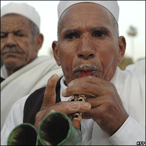 A Libyan man plays a traditional musical