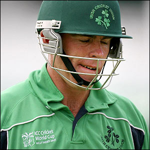 Ireland's captain Trent Johnston leaves the pitch following his dismissal