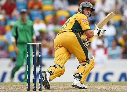 Australia's Michael Hussey flicks the ball away