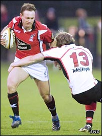 Reivers' Ben MacDougall is held up against Ulster