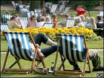Sunbathers in deckchairs
