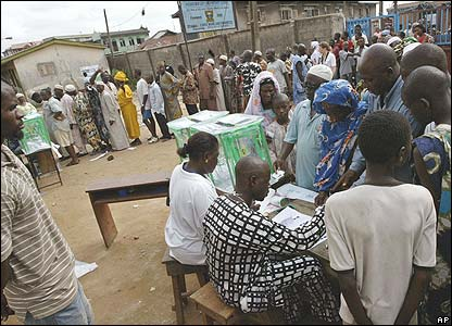 People stand in elections queues during state elections in the city of Lagos