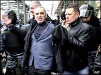 Riot police officers detain Russian opposition leader Garry Kasparov