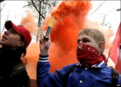 Opposition demonstrators hold flares during a protest march in Moscow.