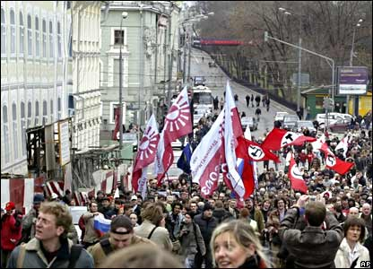 Opposition demonstrators holding their parties' flags march during a protest in Moscow.