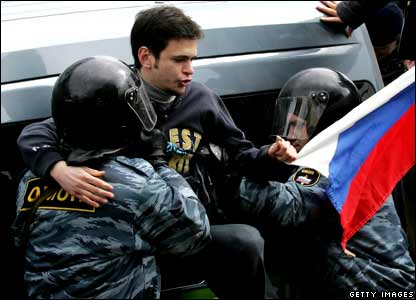 Russian police detain an opposition protester during a protest against Russian Federation President Vladimir Putin.