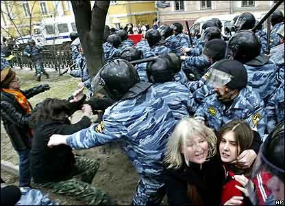 Riot police officers detain opposition demonstrators during a protest in Moscow.