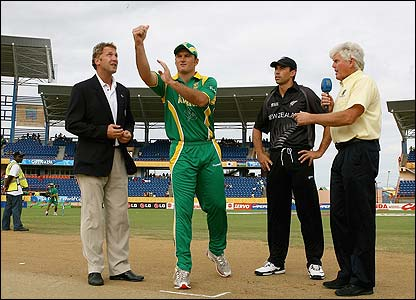 South Africa captain Graeme Smith tosses the coin as Stephen Fleming the New Zealand captain looks on