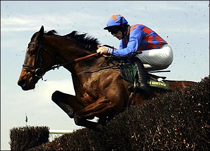 Ruby Walsh on Twist Magic jumps a fence in the Maghull Novices' Chase