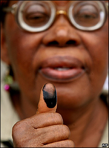 Sixty-four year old woman shows the ink on her thumb after casting her vote in Port Harcourt